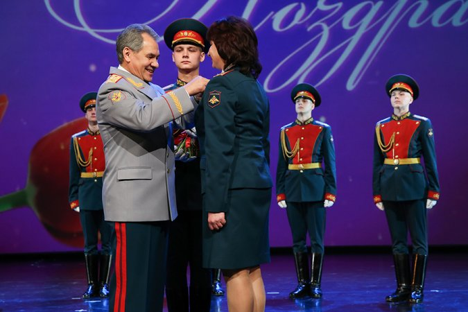 Russian Minister of Defense Sergey Shoigu is awarding his deputy, General of the Army Tatiana Shevtsova