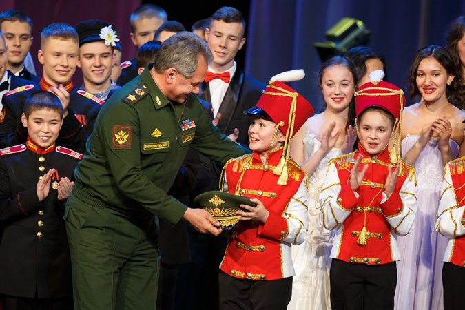 Russian Minister of Defense Sergey Shoigu meets young cadets after performance