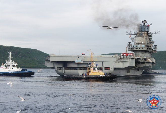 Aircraft carrier Admiral Kuznetsov towed in the harbor of the 35th Ship-Repair Plant