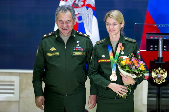 Russian Minister of Defense Sergey Shoigu with a winner of the Military World Games, South Korea
